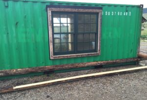 fitting window into container home wall