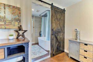 barn door into bathroom
