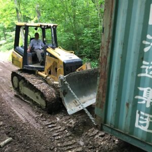 bulldozer dragging container