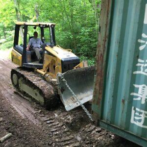 bulldozer dragging container