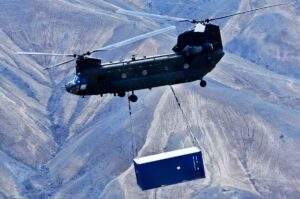 container delivery via helicopter