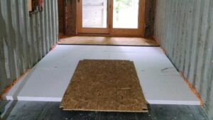 installing underfloor insulation and sub floor